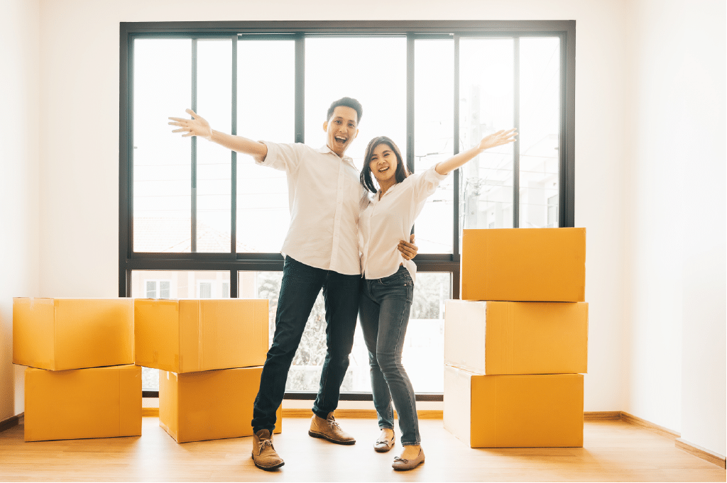 a happy couple in Washington, DC enjoying their moving day